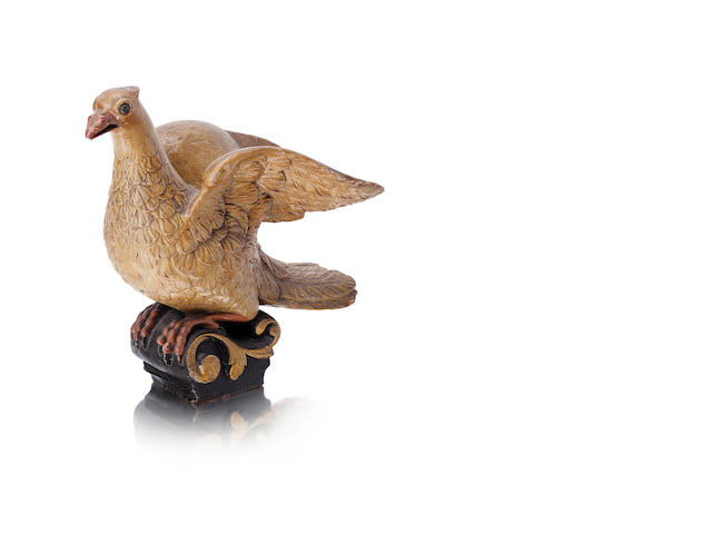 A late 17th or early 18th century carved and painted wood model of a dove