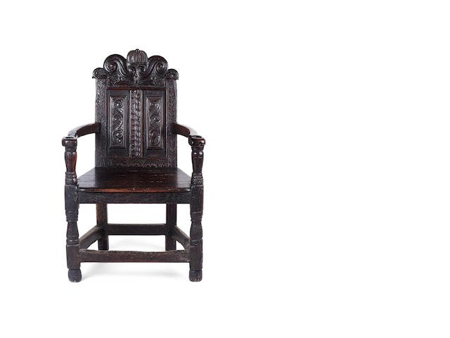 A 17th century Scottish oak and pine cacqueteuse armchair Possibly from Fife