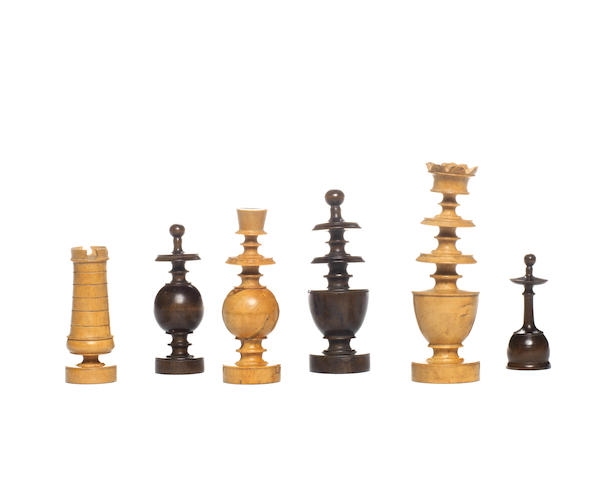 "A French ""Directoire"" boxwood chess set, circa 1800,"