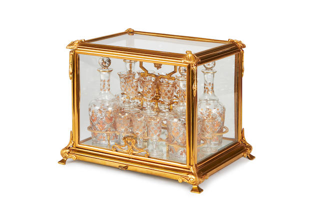 A gilt metal and glass decanter set