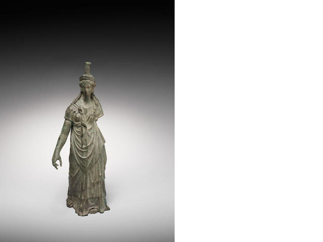 A Roman bronze figure of Isis-Fortuna