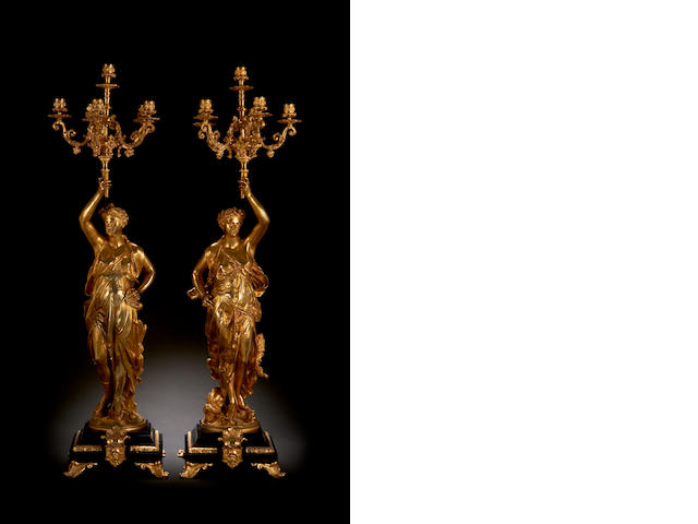 After Jean-Louis Gregoire, French (1840-1890) A pair of gilt metal and polished slate figural candelabra of recent manufacture