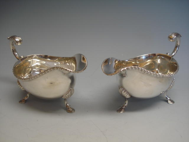 A silver pair of gravy boats,  by Collingwood and Co., London 1965,  (2)