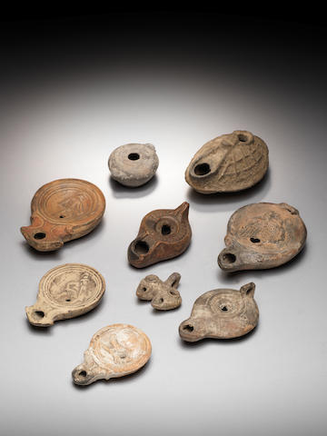 Eight Ancient terracotta oil lamps and a vessel and another pottery oil lamp, 10