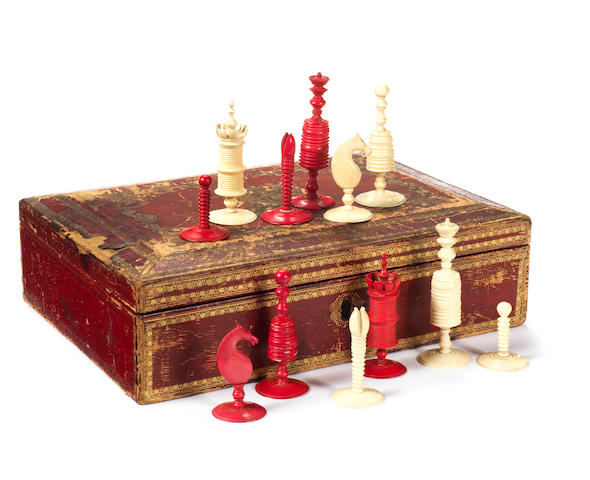 19th century ivory and red stained chess set, in red leather box