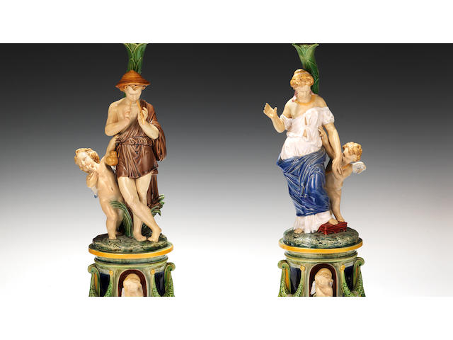 A pair of large Minton Majolica figural candelabra, dated 1878