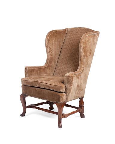 A George I walnut wing armchair