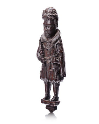 A 17th century carved oak figure of James VI and I