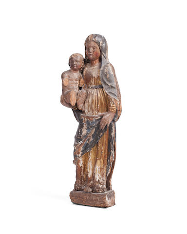 A 16th century South German polychrome decorated and parcel gilt carved limewood figure of the Virgin and Child