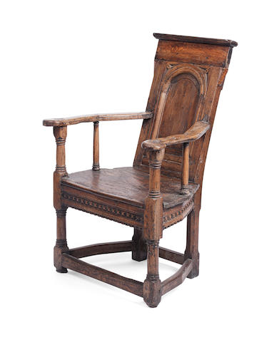 A late 16th/early 17th century French oak caqueteuse armchair