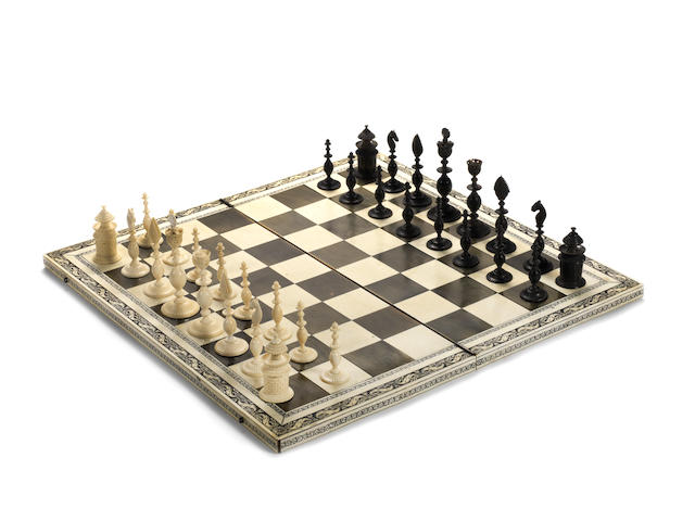An Indian Export ivory and horn chess set and board, Vizagapatam, circa 1830,