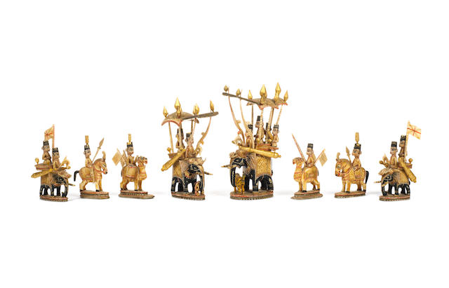 An Indian lacquered ivory figural chess set, Rajasthan, circa 1850,