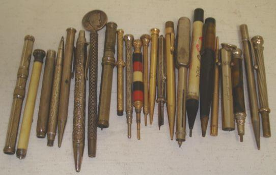 A collection of twenty three vintage propelling pencils,to include three engine turned silver examples, two Mordan Everpoint gold filled examples, Victorian foliate engraved silver propelling pencil, Birmingham 1899, Perry & Co Patent sterling example and an Israel 925 sterling example highly decorated.(23)