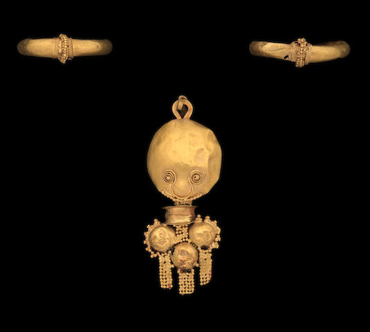 A pair of Greek gold earrings and a Roman gold earring 3