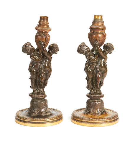 A pair of late 19th / early 20th century French bronze figural lamp bases