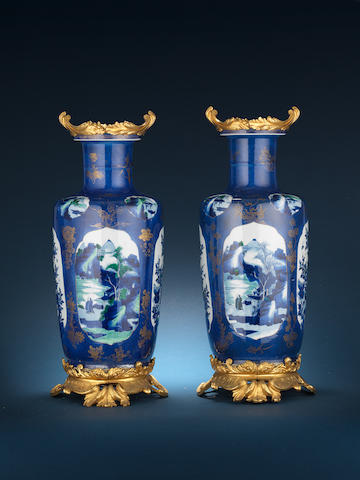A fine and rare pair of ormolu-mounted famille verte powder-blue-ground baluster vases The porcelain Kangxi, the mounts early 19th century, probably French