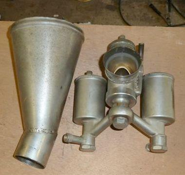 Two twin-float carburettors,