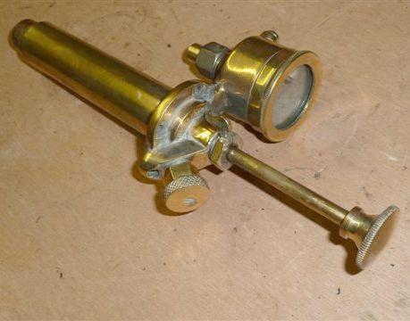 A 1920s auxiliary hand-operated oil pump,