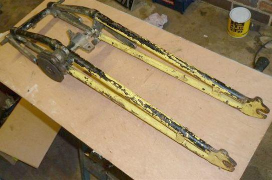 Sunbeam girder forks and a pre-War BSA girder fork head set,