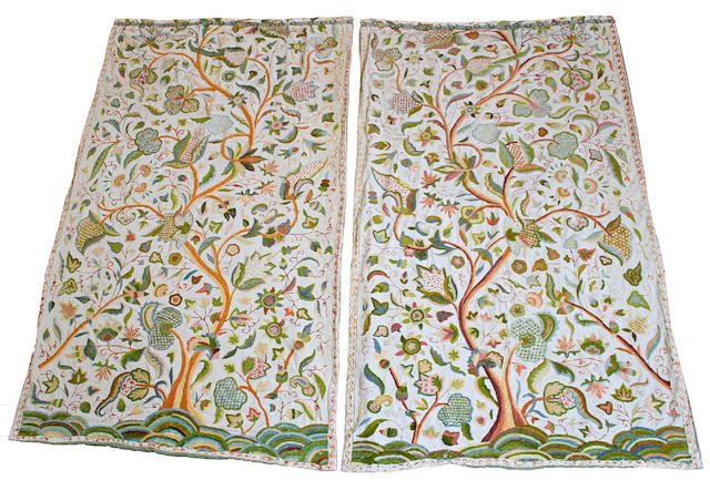 A pair of early 20th century crewelwork curtains