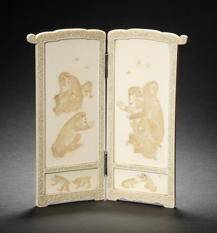 An ivory two-fold table screen By Yoshiaki, Meiji Period