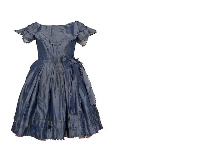 A girl's silk dress, circa 1850s