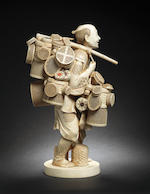 A tall ivory okimono of a basket seller By Josetsu, Meiji Period