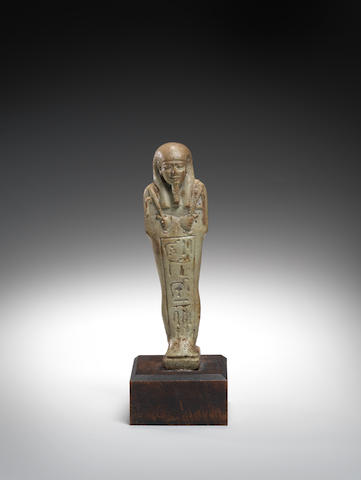 An Egyptian pale green glazed composition shabti,