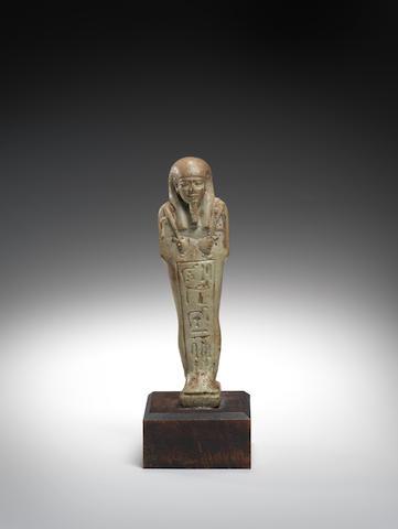 An Egyptian pale green glazed composition shabti,