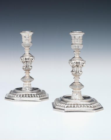 A pair of William III cast silver candlesticks, maker's mark IL beneath a crown and in shield-shaped punch London 1697,  (2)