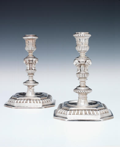 A matched pair of William III cast silver candlesticks, by Joseph Bird, London 1699. and the other by Edward Gibson (?), London 1694, one sterling standard the other Britannia,  (2)