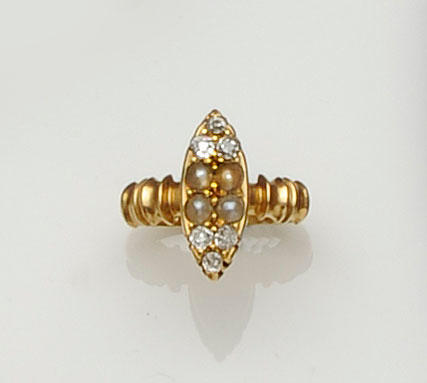 An 18ct gold diamond and seed pearl marquise shaped panel ring