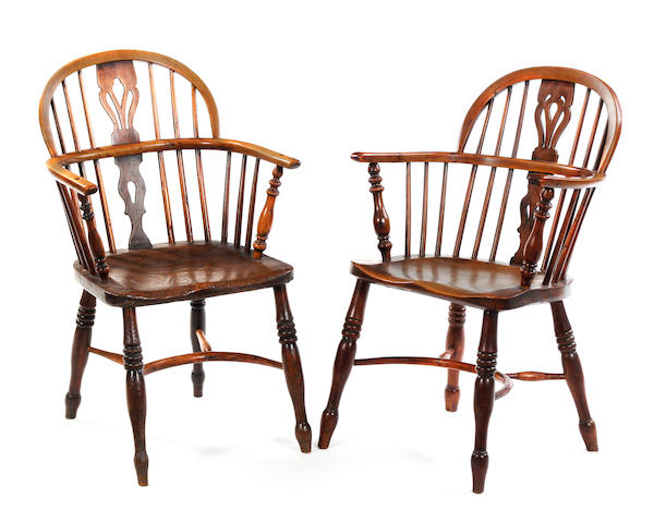 A 19th century yew and elm low Windsor armchair