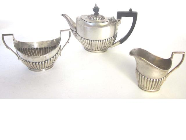An Edwardian silver three-piece bachelor's tea service, By Mappin & Webb, Sheffield 1901,