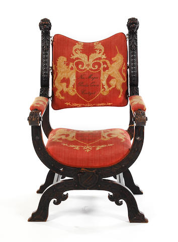 A 19th century oak Savonarola armchair