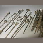 A quantity of various electroplated meat skewers,