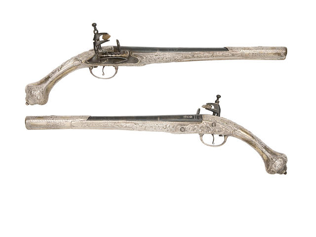 A Pair Of Balkan 18-Bore Miquelet-Lock Holster Pistols With Silver Stocks And Mounts