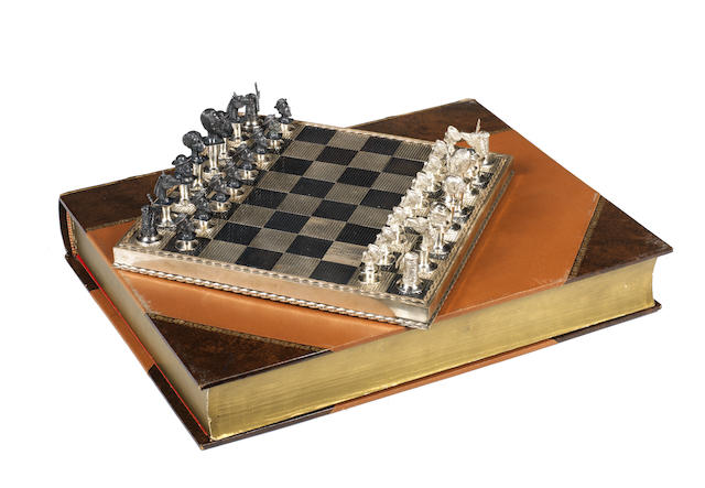 "A ""silver coloured metal"" Don Quixote bust chess set, Spanish, circa 1970,"