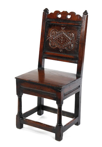 An oak back stool 17th century and later
