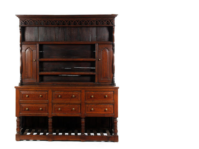 An unusual 18th century style oak high dresser