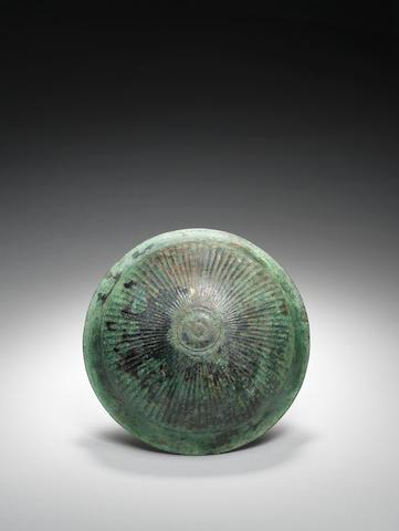 A Greek bronze phiale
