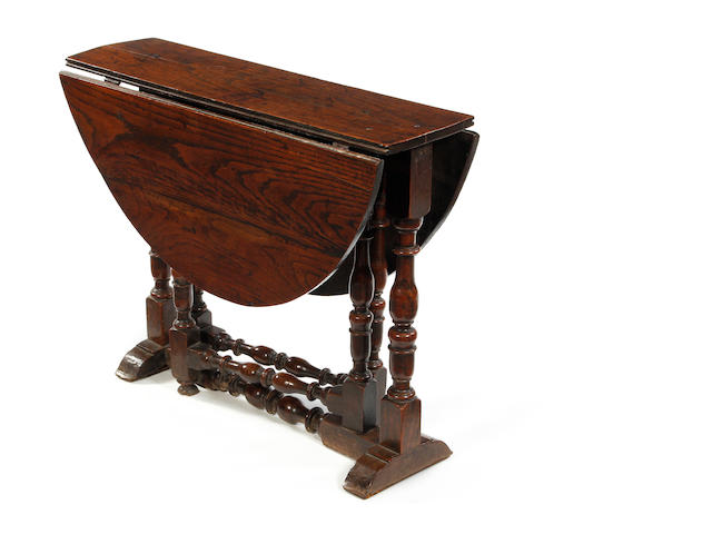 A Charles II oak gateleg occasional table