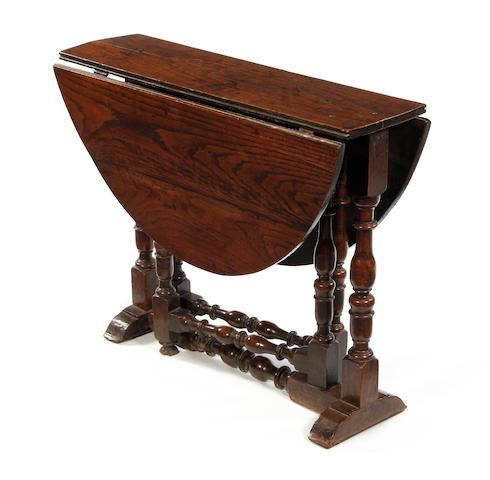 A Charles II oak gateleg occasional table