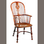 A mid-19th century yew, elm and ash high-back Windsor armchair