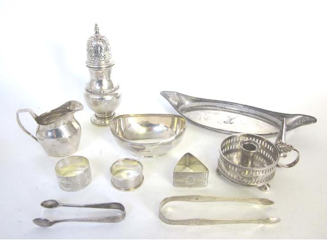 A George III silver chamberstick and conical extinguisher, maker's mark script WT probably for William Tweedie, London 1810,  together with 3 napkin rings, oval dish, cream jug, sugar caster, and tongs(10)