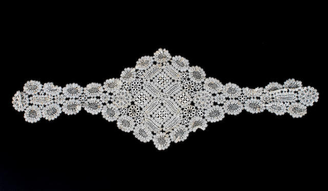 A 19th century fall cap of delicate and elaborate tatting