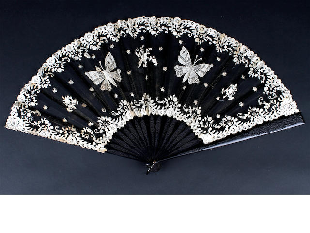 A large mixed Brussels lace fan on carved wood sticks