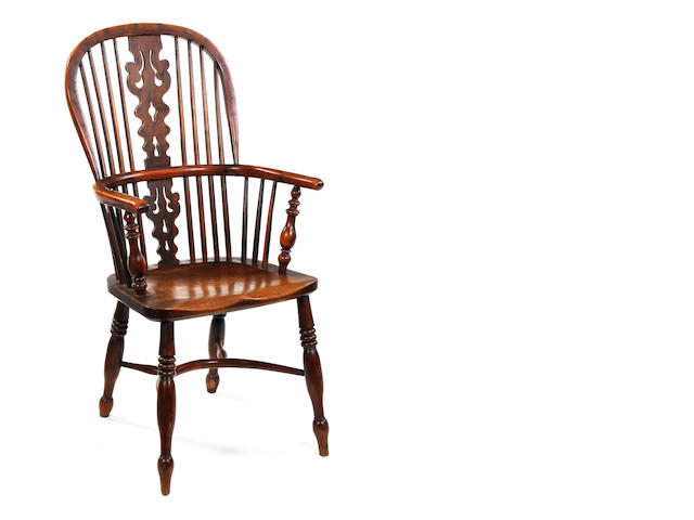 A mid-19th century yew high back Windsor chair