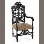 A 19th century Renaissance Revival stained walnut open armchair