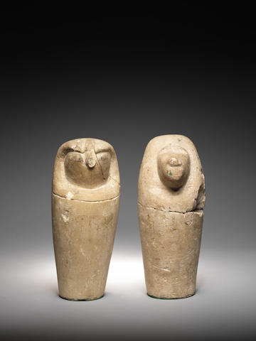 A pair of Egyptian limestone dummy canopic jars 2